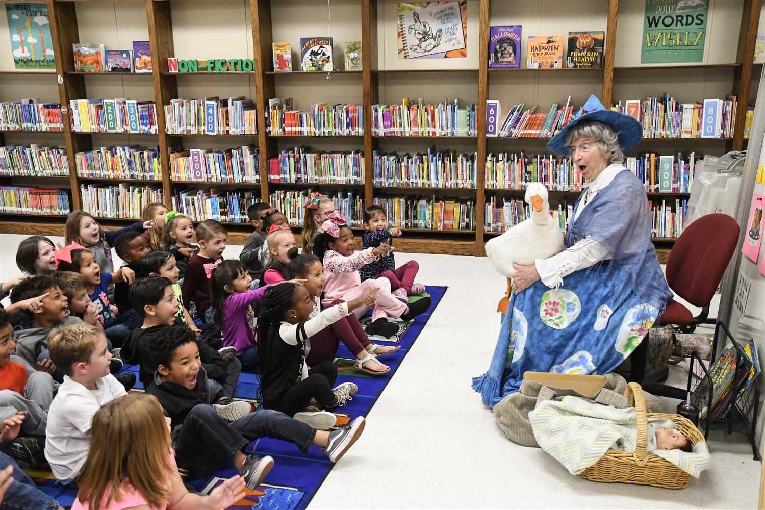 Mother Goose entertains primary students.
