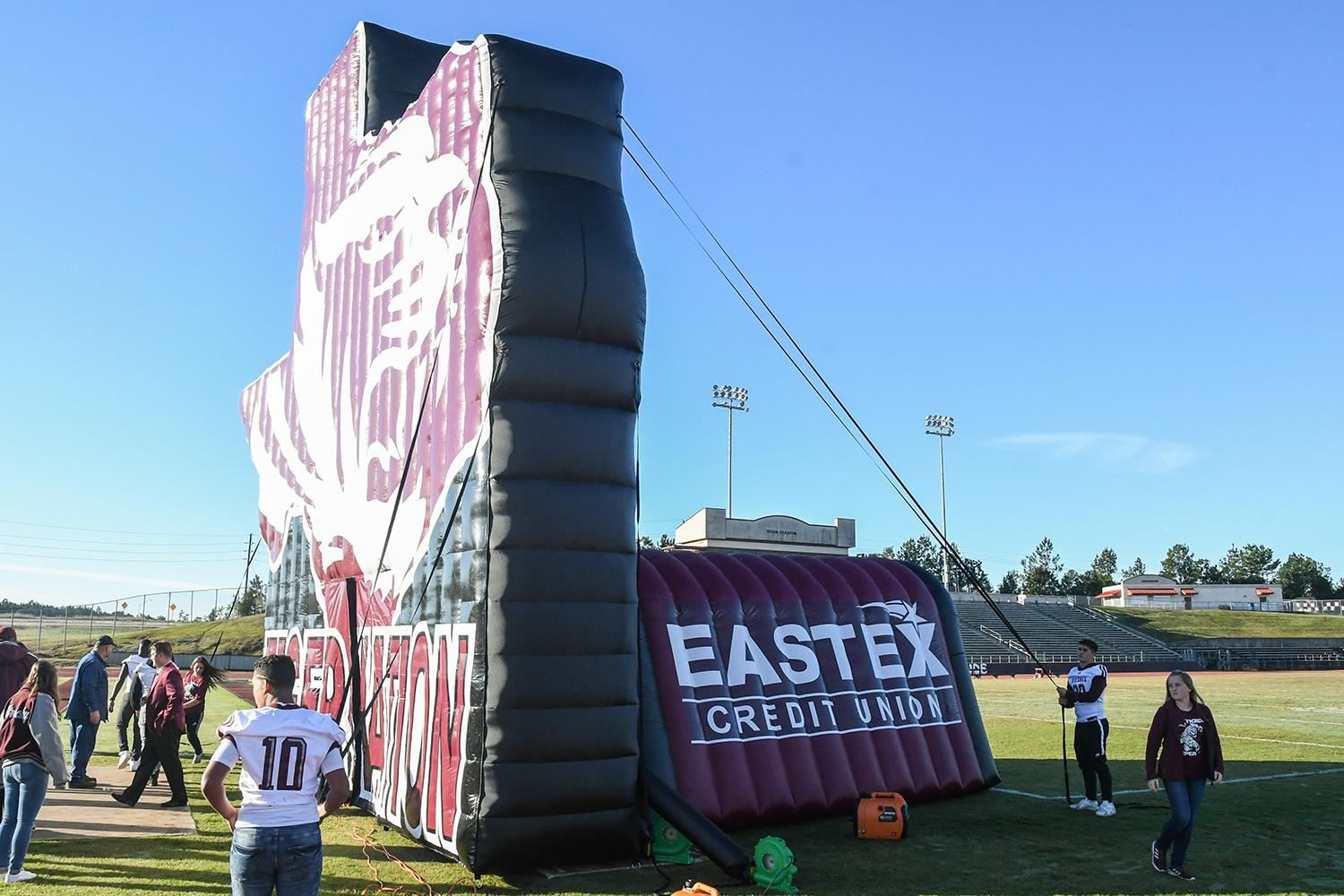 Tiger tunnel displaying Eastex Credit Union logo