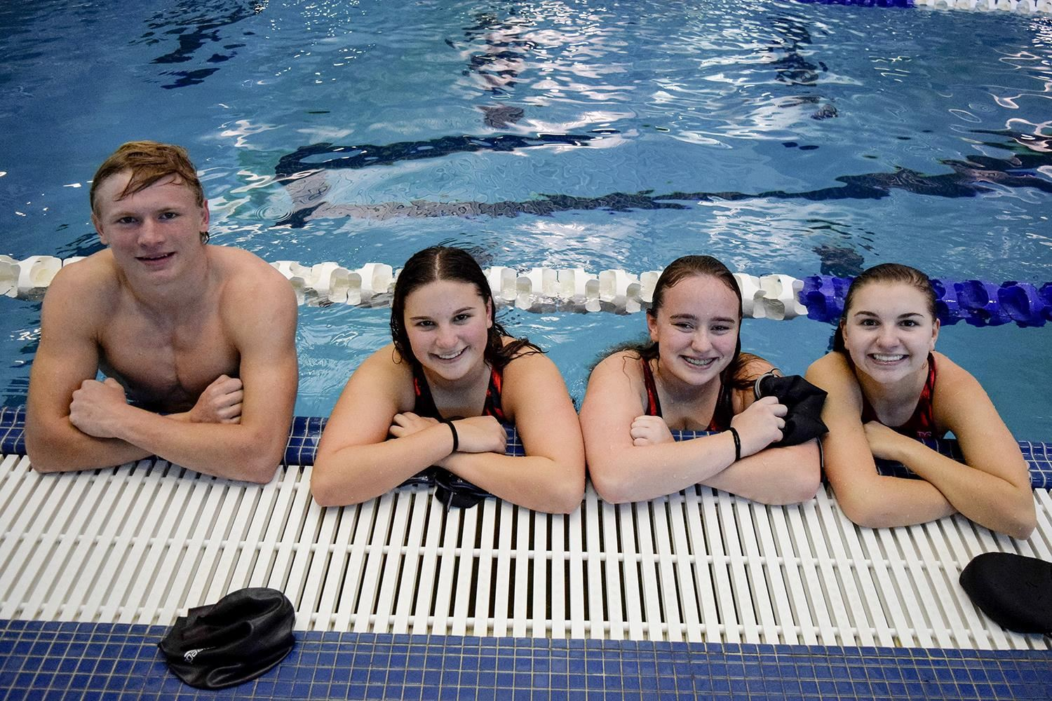 Swimmers pose in the pool