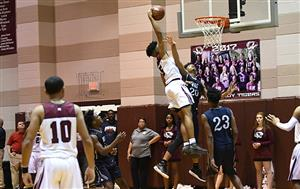 Photo of Jordyn Adams dunking the basketball