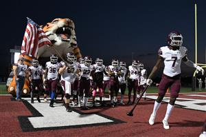 Photo of football team exiting Tiger tunnel at football game